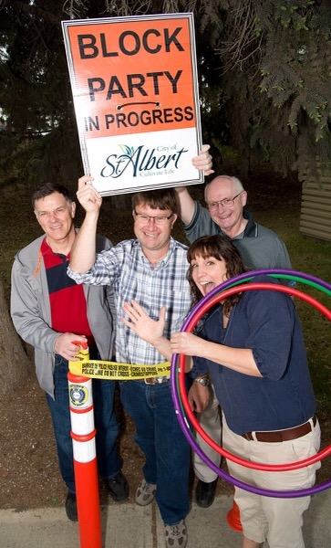 PAR-TAY! — Serge Poirier, Matt Garvin, Dale Fetterly, and Angie Dedrick party down to show their support for the Good Neighbour Project. The four are part of the project's push to get a block party on every street in St. Albert. KEVIN MA/St. Albert Gazette